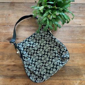 Large black and gray Coach shoulder bag.
